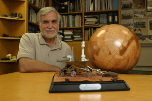 Ronald Greeley with a Mars Exploration Rover model and globe
